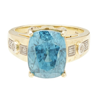 Lot 35-An 18ct gold zircon and diamond set cocktail ring