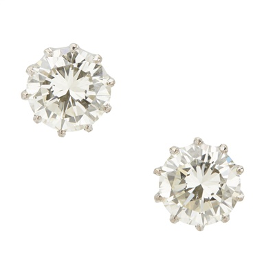 Lot 2-A pair of diamond set ear studs
