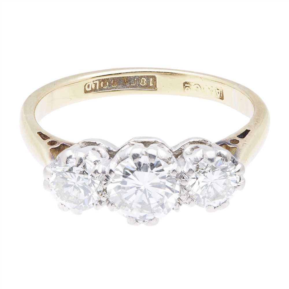 Lot 15-A three stone diamond set ring