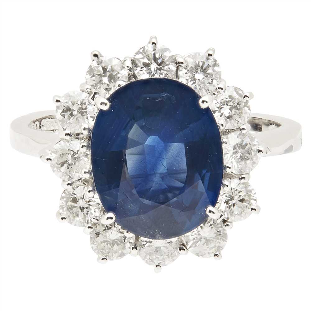 Lot 7-A sapphire and diamond cluster ring