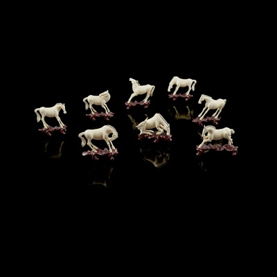 "Lot 29-COLLECTION OF EIGHT IVORY HORSES - ""HORSES OF MU WANG"""