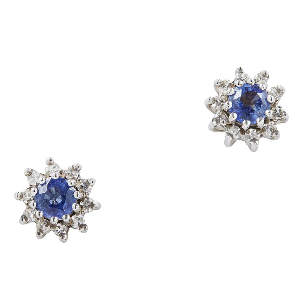 Lot 10-A pair of sapphire and diamond set cluster earrings