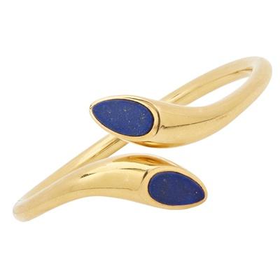 Lot 32 - A 1970s lapis lazuli set bangle