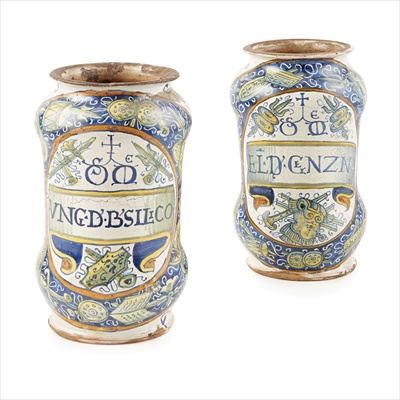 Lot 5-PAIR OF UNRECORDED ITALIAN MAIOLICA ALBARELLOS, FROM A SET OF PHARMACY JARS BY ANDREA DI MARCO DI IACOPO DE LE SCINE