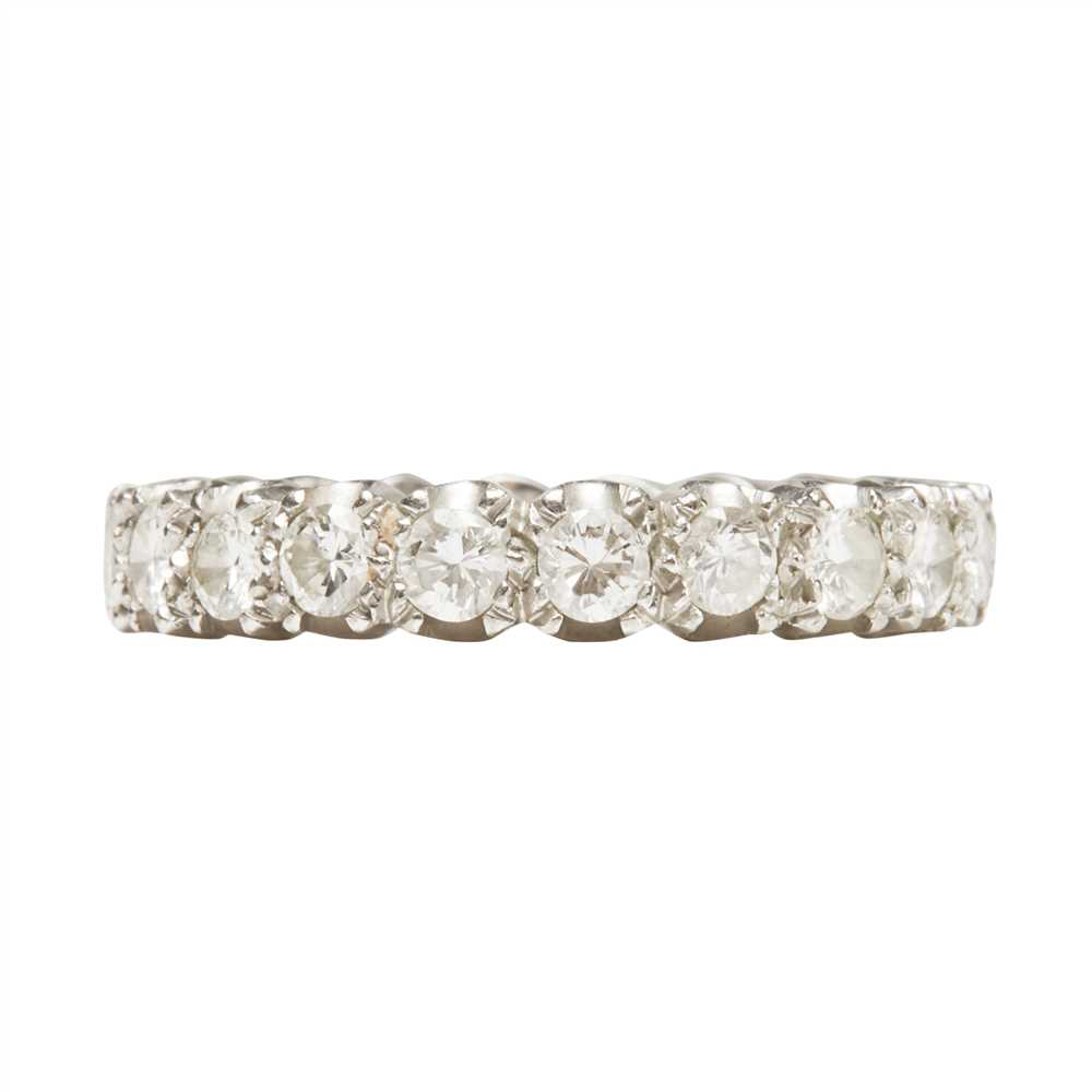 Lot 21-A diamond set eternity ring