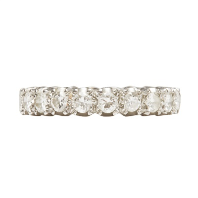 Lot 21-A diamond set eternity ring