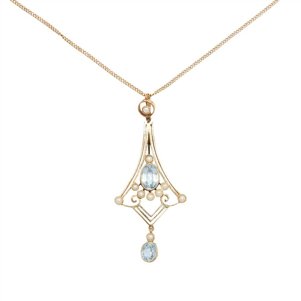 Lot 2-An early 20th century aquamarine and seed pearl set pendant