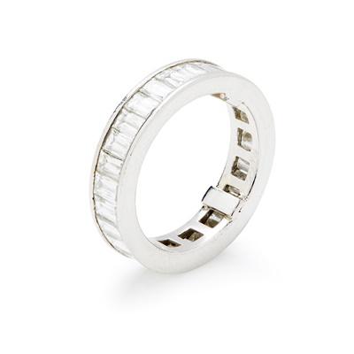 Lot 27-A diamond set eternity ring