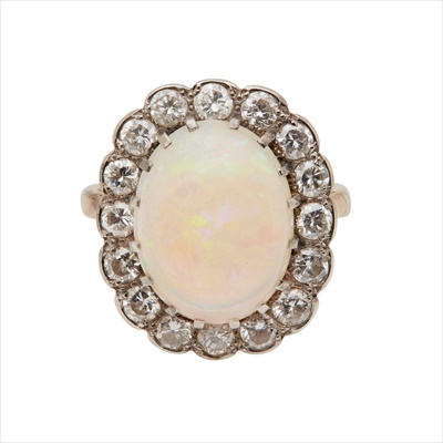 Lot 9-An opal and diamond set cluster ring