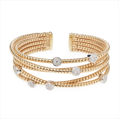 Lot 22-A modern multi-strand diamond set bangle