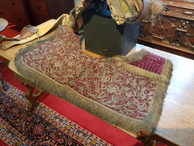 Lot 14-OTTOMAN SADDLE AND METAL-THREAD EMBROIDERED RED GROUND SADDLE CLOTH