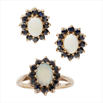 Lot 10-An opal and sapphire set cluster ring