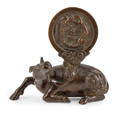 Lot 38-BRONZE MIRROR AND 'RHINOCEROS' STAND
