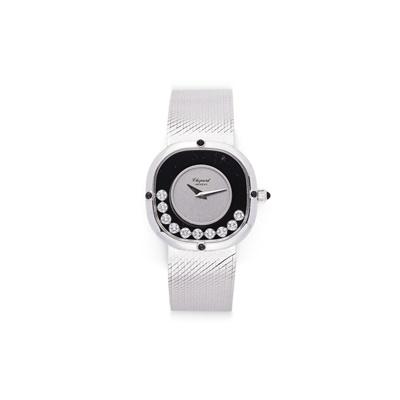 Lot 48 - An 18ct white gold 'Happy Diamond' wristwatch, by Chopard