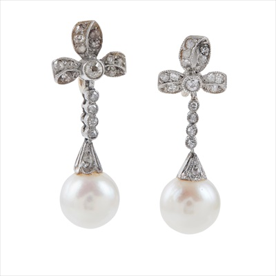 Lot 6-A pair of early 20th century pearl and diamond set pendant earrings