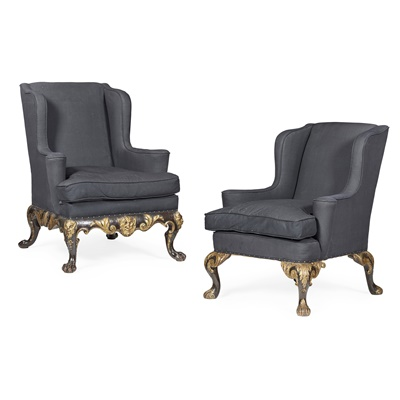 Lot 22-TWO GEORGE II STYLE EBONISED MAHOGANY AND PARCEL GILT WING ARMCHAIRS