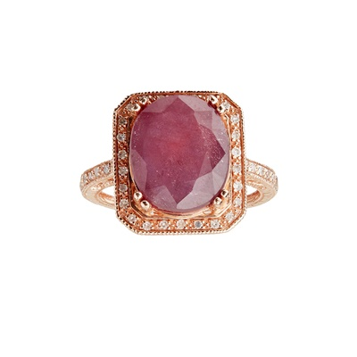 Lot 105 - A ruby and diamond set cluster ring