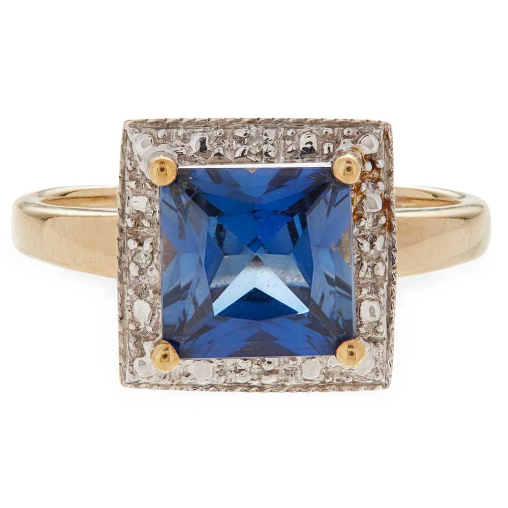 Lot 11 - A synthetic sapphire and diamond set ring