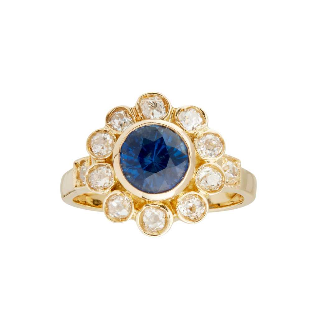 Lot 14-A sapphire and diamond cluster ring