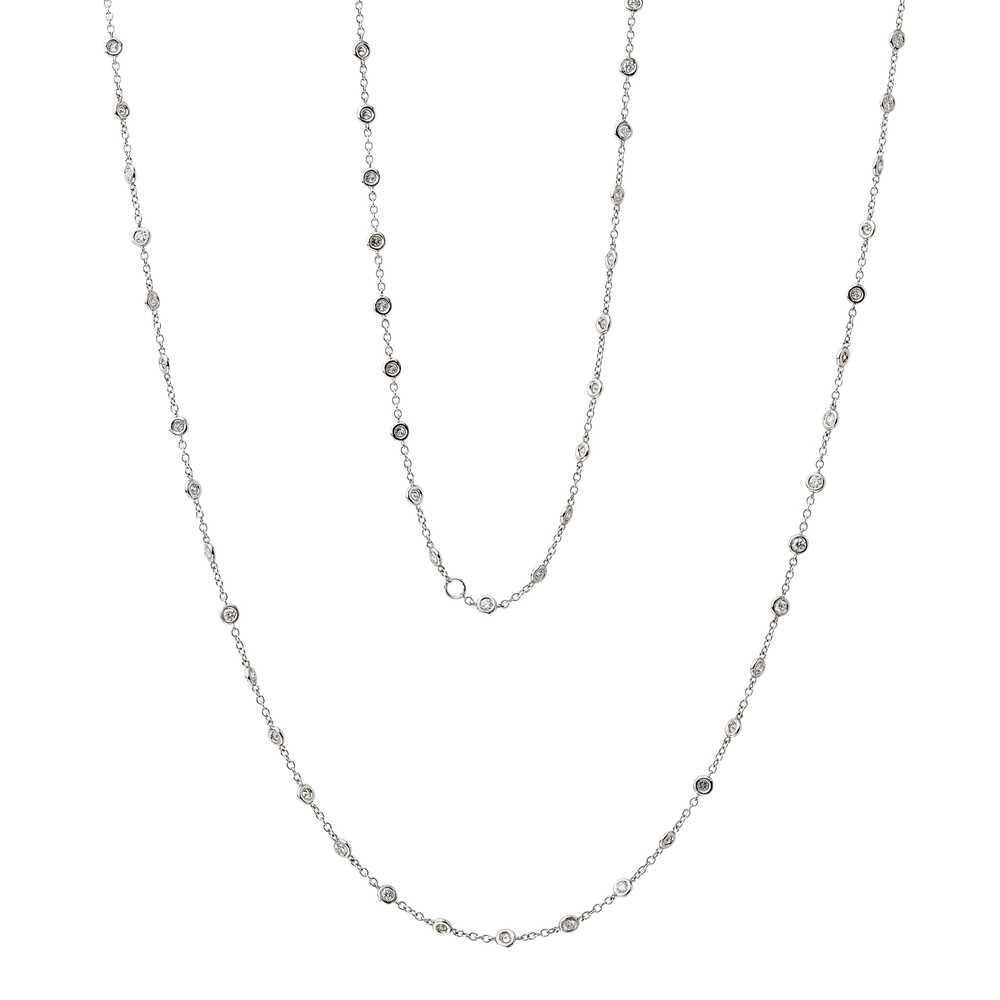 Lot 19 - A diamond set long chain