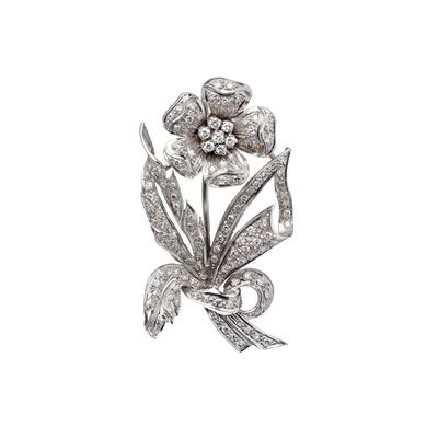 Lot 66-A diamond set floral spray brooch