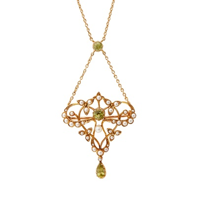 Lot 1-An early 20th century peridot and pearl set pendant necklace