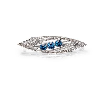 Lot 32-A sapphire and diamond set brooch