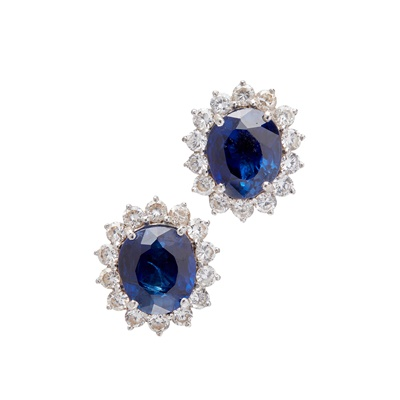 Lot 15-A pair of sapphire and diamond set cluster earrings