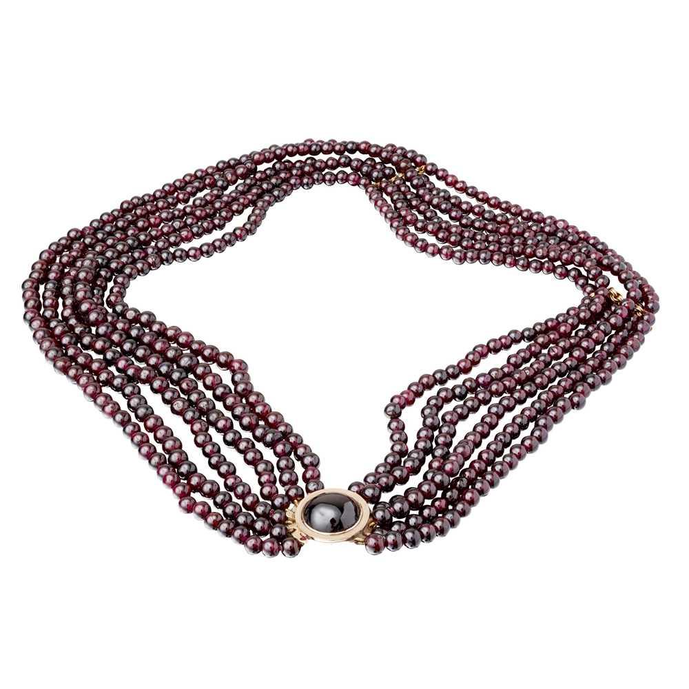 Lot 100 - A six strand garnet bead necklace