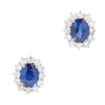 Lot 23-A pair of 18ct gold sapphire and diamond set cluster earrings