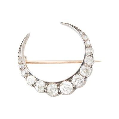 Lot 45 - A Victorian diamond set crescent brooch
