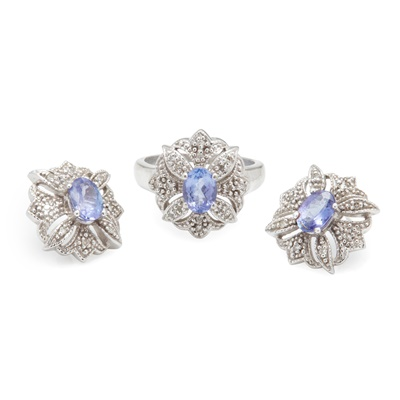 Lot 26 - A Tanzanite and diamond cluster ring and matching earrings