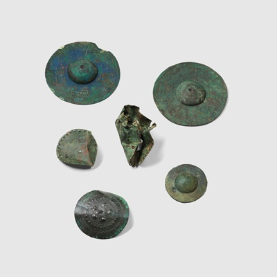 Lot 33 - COLLECTION OF ANCIENT NEAR EASTERN SHIELD BOSSES AND FITTINGS