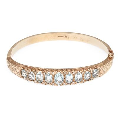 Lot 35 - A 9ct gold aquamarine and diamond set bangle