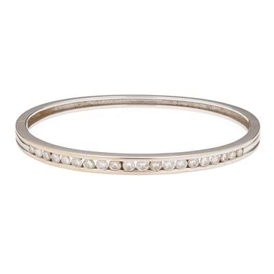 Lot 28 - A 18ct white gold diamond set bangle