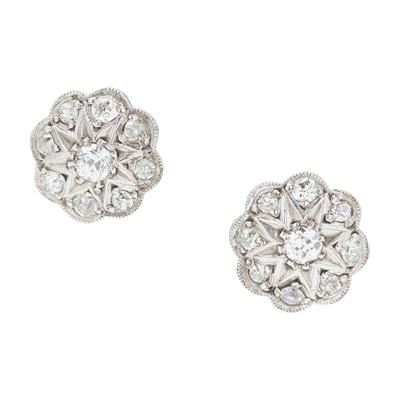 Lot 46 - A pair of diamond set cluster earrings