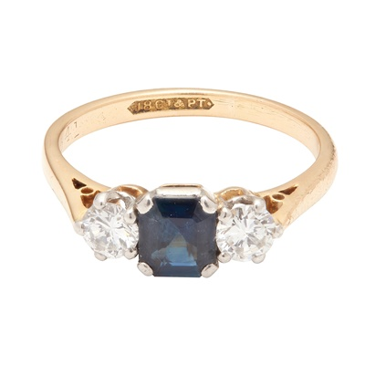 Lot 24-A sapphire and diamond set three stone ring