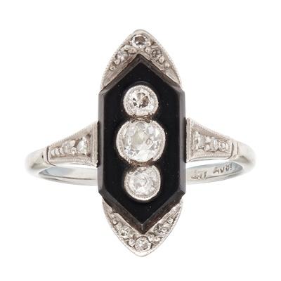 Lot 64 - An Art Deco onyx and diamond set ring