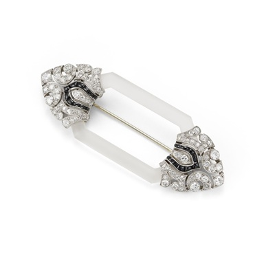 Lot 32 - An Art Deco frosted rock crystal, onyx and diamond brooch, circa 1925