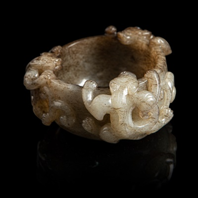 Lot 69 - GREY AND RUSSET JADE 'CHI DRAGON' CUP