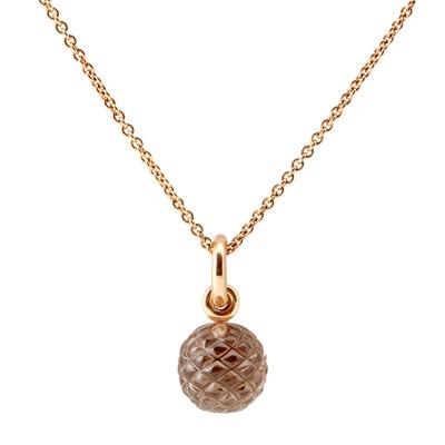 Lot 78 - A carved smokey quartz set pendant