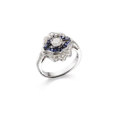 Lot 52 - A sapphire and diamond dress ring