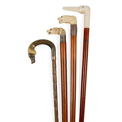 Lot 27 - FOUR CARVED HANDLE WALKING CANES