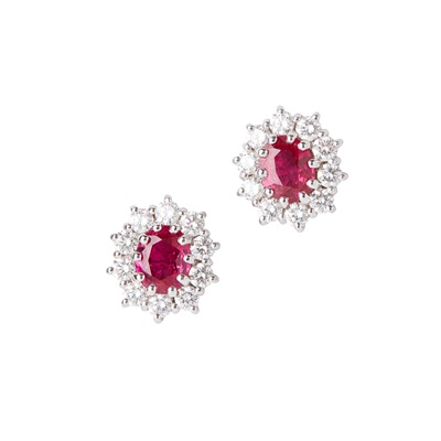 Lot 3-A pair of ruby and diamond set cluster earrings