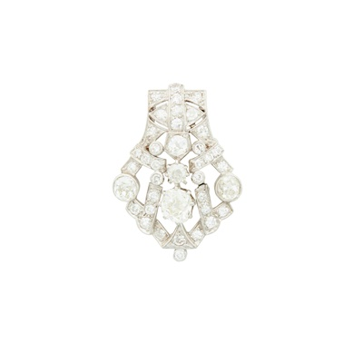 Lot 32-An early 20th century diamond set brooch/ pendant