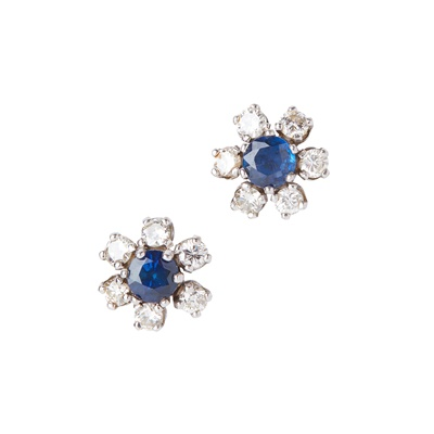 Lot 31-A pair of sapphire and diamond set cluster earrings