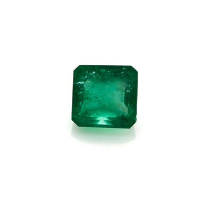 Lot 19-An emerald and diamond set cluster ring