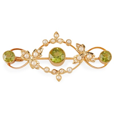 Lot 41-An Edwardian peridot and pearl set brooch