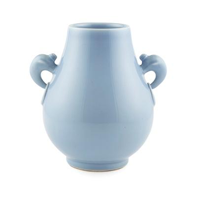 Lot 103 - SKY-BLUE-GLAZED ELEPHANT HANDLED VASE