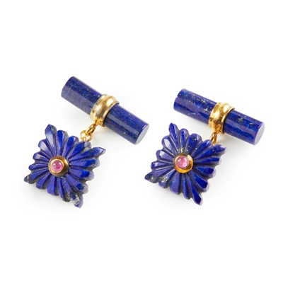 Lot 28-A pair of ruby and lapis lazuli set cufflinks